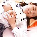 Akane Sakura naughty schoolgirl playing with her tits and pussy