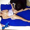 Sakurako Asian in fishnet stockings screws her slit with vibrator