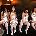 Japanese AV Model with three babes in white lace exposing boobies