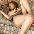 Kyoko Ayana masturbating on the couch during this video