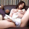 Yu Chubby Asian chick with big tits gets a big dildo in her hairy pussy
