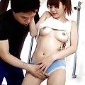 Sakurako Asian in stockings feels phallus at her cunt entrance