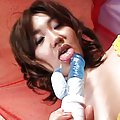 Rin Asian horny slut licks blue dildo while playing with titties
